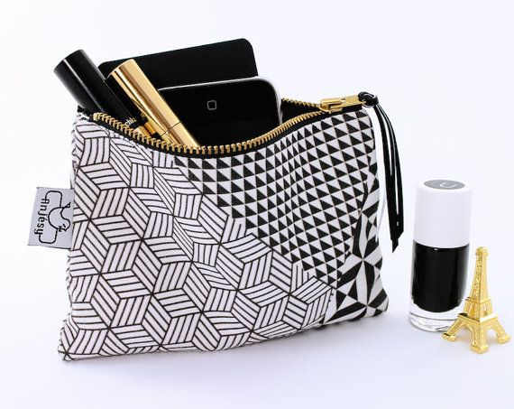 This gorgeous geometric hand screen printed pouch has been designed to hold of your everyday essentials such as credit cards, cash, sunglasses, phone, etc... Each clutch is lovingly and carefully made by hand and features an eye catching original ANJESY textile design.  All my items are designed and handcrafted /hand screen printed/sewn by me in my studio in Paris, France.  ------------------------------------------------------- Approximate measures : MEDIUM : 7  x 4,9 ( 18 cm x 12,...