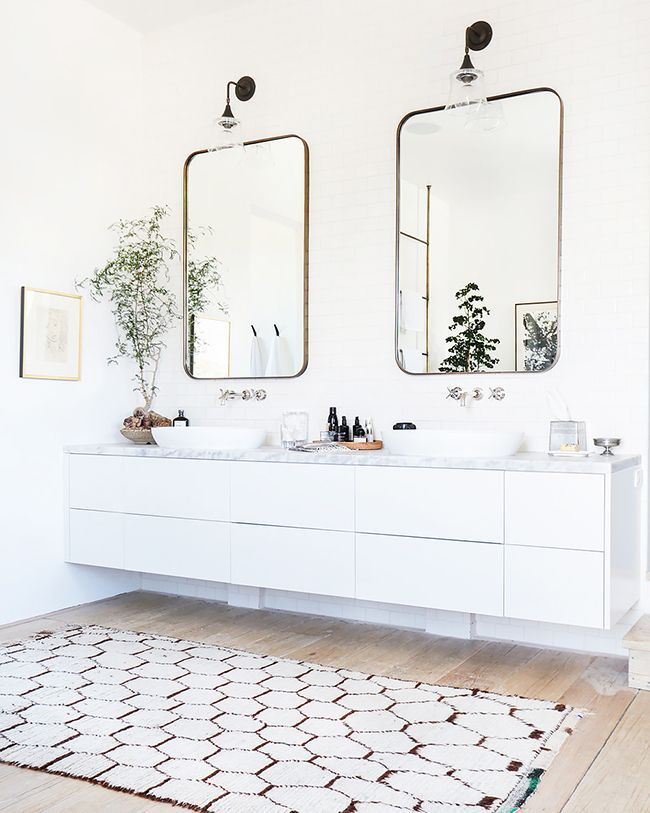 his and hers vanity and moroccan rug in vanessa master bath