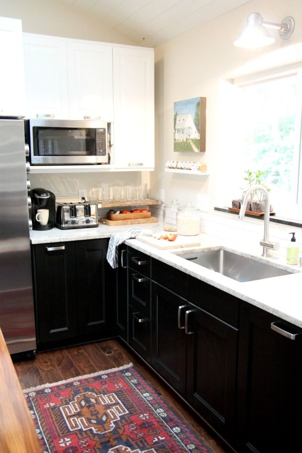 kitchen white upper cabinets dark lower white black lower cabinets and a rug that looks 22186