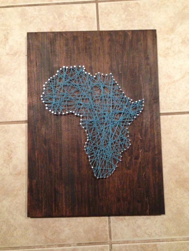 My first DIY project inspired by others I've seen on pinterest. Stained wood with Expresso finish, printed out pic of Africa, nailed in all the nails and used the same piece of string to string together all of the nails!  #Africa #stringart