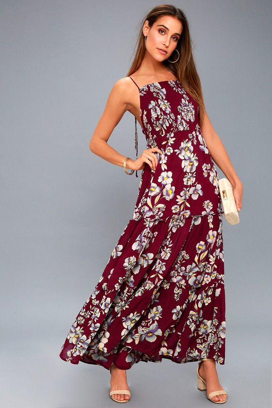 Celebrate among the azaleas and roses with the Free People Garden Party Burgundy Floral Print Maxi Dress! Woven rayon, with a floral print in shades of white, yellow, grey, and burgundy, shapes a smocked bodice, with an apron neckline, overlapping sides, and tying, skinny straps. Tiered skirt cascades to a maxi length.