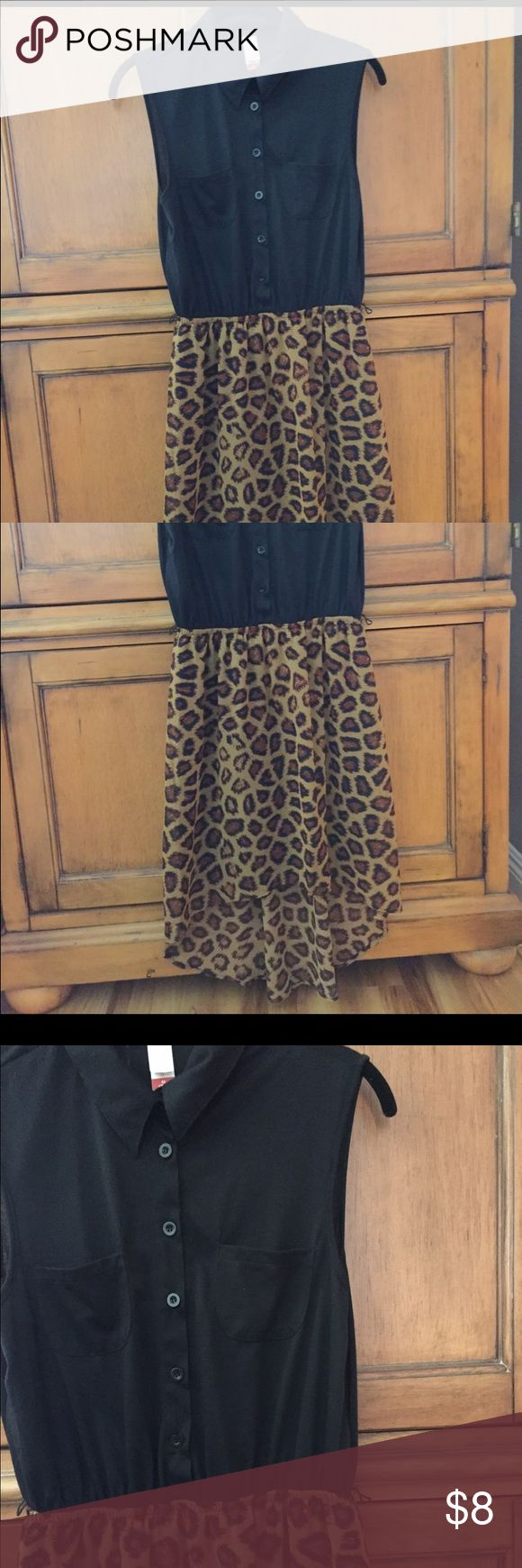 A cheetah dress! Super cute and comfortable! The dress is still in great condition! Cute, trendy and stylish! A dress that can go with anything.. really! Dresses High Low