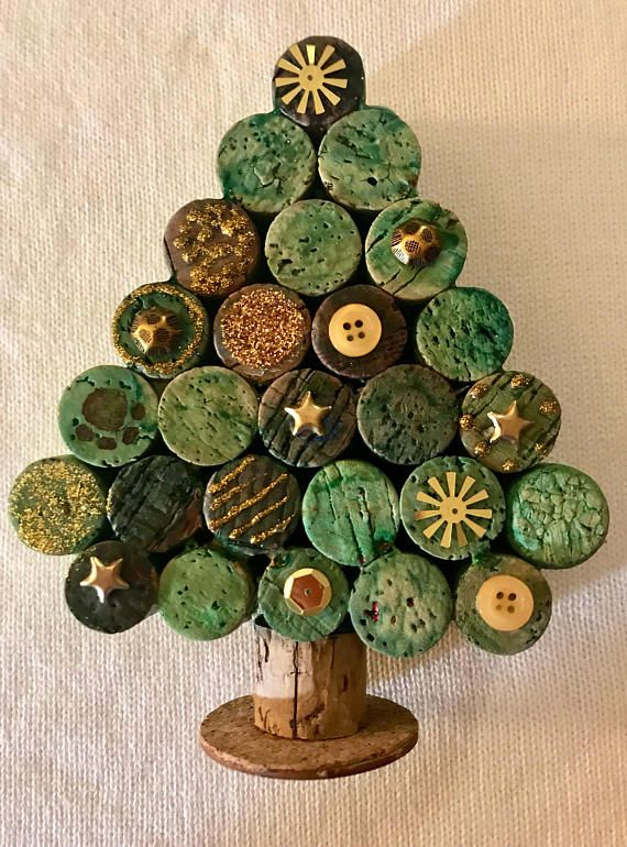 "CORK THERAPY wine cork Christmas Tree. This 7"" x 5"" tree will look great sitting on your mantle or desk at work during the holiday season, or would be a perfect gift from your secret Santa! Each of these trees are unique, using different corks and embellishments. The corks are dyed prior to assembly to give them a more natural look, verses using paint like other sellers do. So the tree you receive will be slightly different that the picture. XX50"