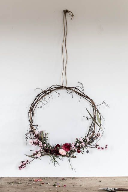 DIY wreath using a mixture of plants and flowers.
