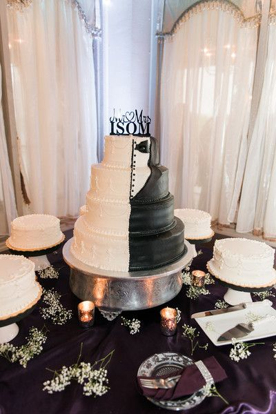 """<strong class='info-row'>Rania Marie Photography</strong> <div class='info-row description'><html>  <head></head>  <body>    After dinner, guests were treated to a four-tier cake, which was decorated in a half-tuxedo design.  Venue:   <a href=""""https://www.weddingwire.com/biz/crystal-ballroom-on-the-lake-altamonte-springs/4deca0032d975faa.html"""" target=""""_blank"""">Crystal Ballroom on the Lake</a>   </body> </html></div>"""