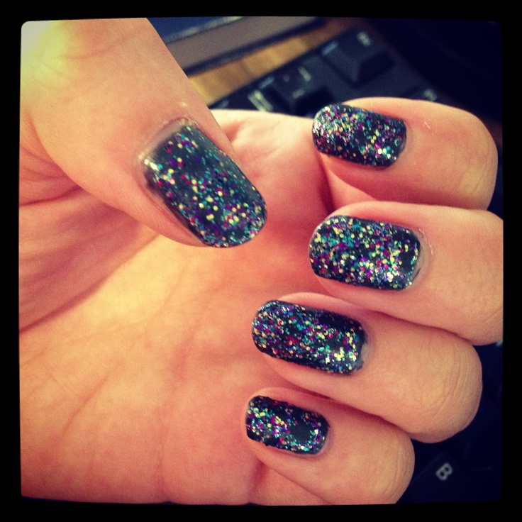 I did this with a LED shellac nail kit. Dark grey shellac with Barry M glitter polish on top. A La Rockstar nails... Sort of.
