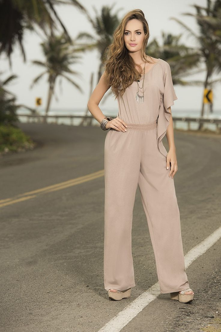 Look ravishing in ruffles! This sexy jumpsuit has an assymetrical design with a flowing ruffle sleeve on one side and a sleeveless fit on the other. A braided elasticated band accentuates the waist before the jumpsuit finishes with flowing wide legs. Available in Black and Mocha.  Order online: https://lushwear.co.za/j1848-mocha Price: R1,095.00  #lushwear #lushwearsa #fashion #jumpsuit #southafrica