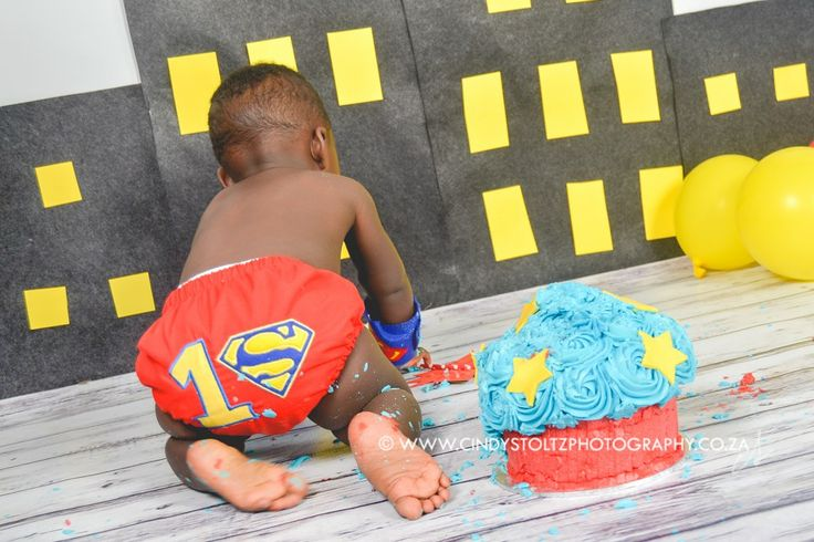Big-eyed Jaden came to visit for a super-cute Superman cake smash! Adorable custom outfit by Subella Baby Boutique Super-cute cake by Baked With Love