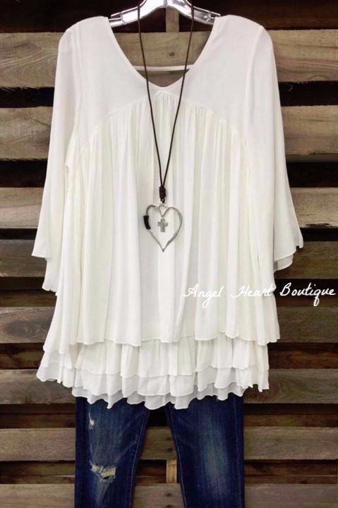 A gorgeous multi layer ruffle tunic with 3/4 sleeves. - 68% Rayon - 32% Polyester - Hand Wash - Cold Wash