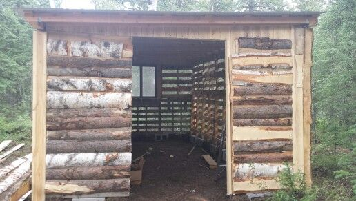 Pallet shed with roof and slab wood siding small town for Log slab siding