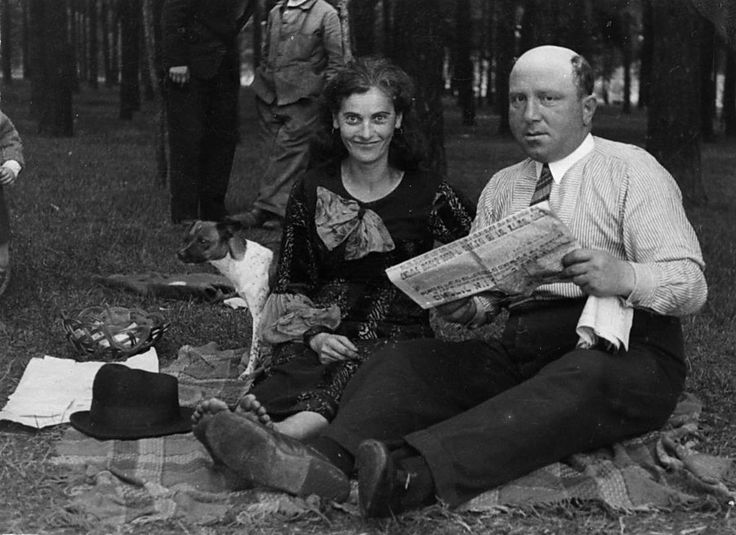 """Anonymous couple, man reading a newspaper in Yiddish"" Poland, 1930s"