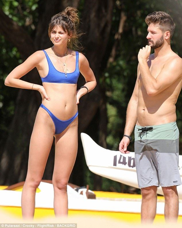 a8f714aa81e0 Taylor Hill, 21, and her 32-year-old boyfriend Michael Stephen Shank  enjoyed the perfect weather in Hawaii on Tuesday, as the couple strolled  the beach and ...