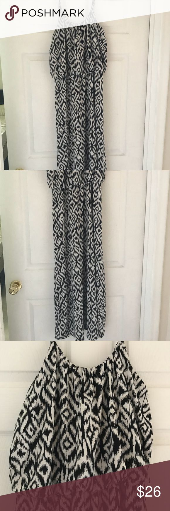Tribal Maxi dress Black & white tribal print maxi dress. Has adjustable straps, not see through at all!! Is cinched under the bust and creates a flouncy, overlay look. Made with lycra so it is super stretchy! Size tag was cut out for comfort, but it is a medium. Dresses Maxi