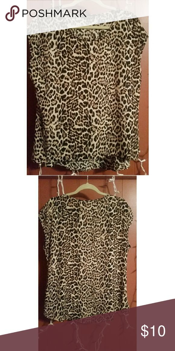 Cheetah print shirt Never worn, but does not have tags. Size xl but it runs small. Perfect condition. The hem of the shirt is slightly longer in the back. HeartSoul Tops Blouses