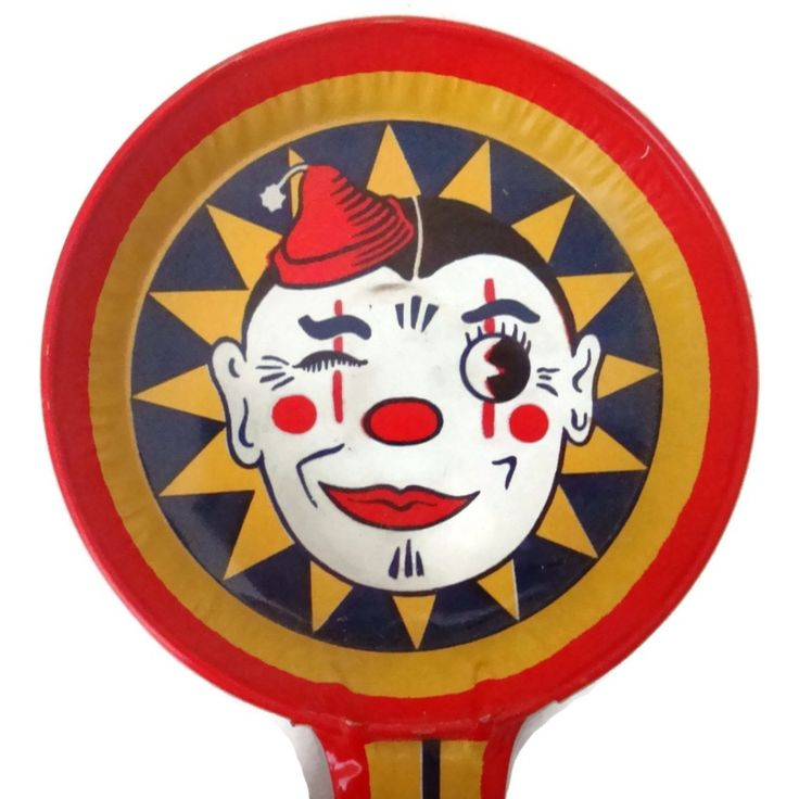 Vintage T Cohn Halloween noisemaker, smiling clown face (c 1950s)