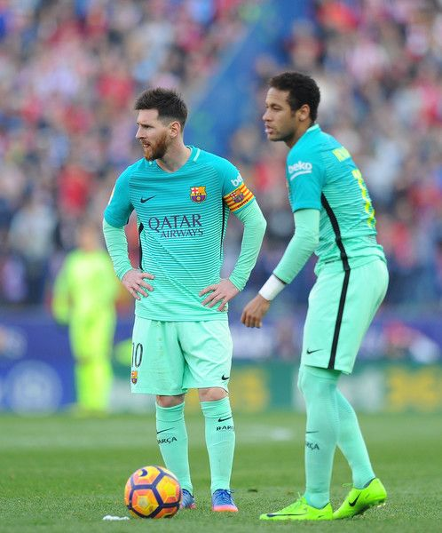 Lionel Messi of FC Barcelona lines up a free kick with Neymar during the La Liga match between Club Atletico de Madrid and FC Barcelona at Vicente Calderon Stadium on February 26, 2017 in Madrid, Spain.