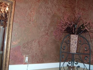 Brown Paper Bag Wall Treatment...tear pieces of brown paper or red rosin paper and spray paint them to get the color you want. First crinkle the chunks and then spray. I did my bathroom in a copper and gold