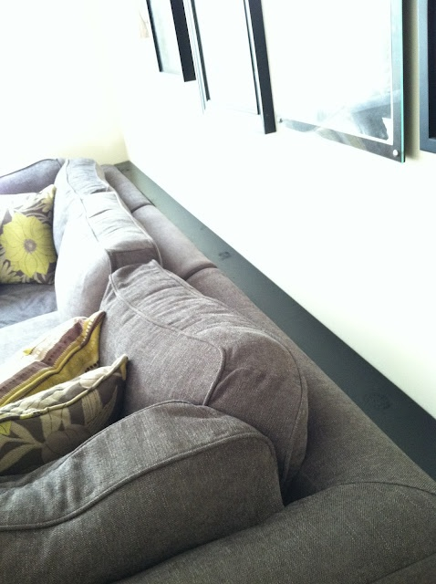 shelf behind couch to stop things from falling behind. Black Bedroom Furniture Sets. Home Design Ideas