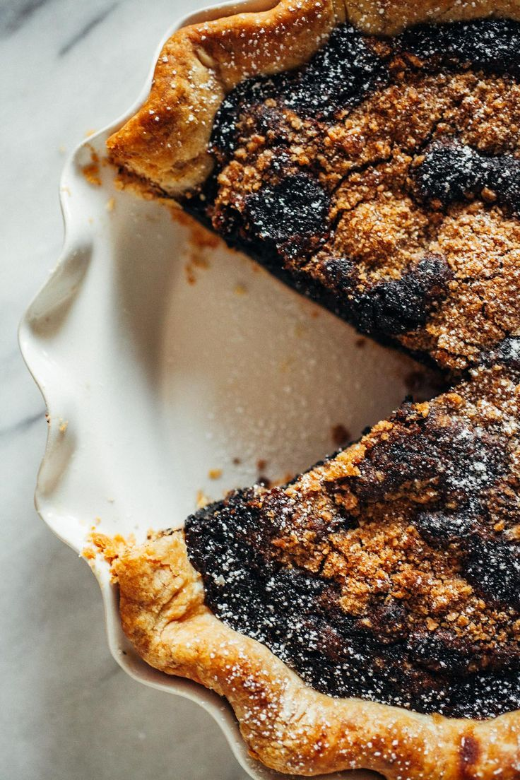 Shoofly Pie: a sweet, custard-like pie made with molasses, cinnamon, and sugar with a buttery crumb topping.