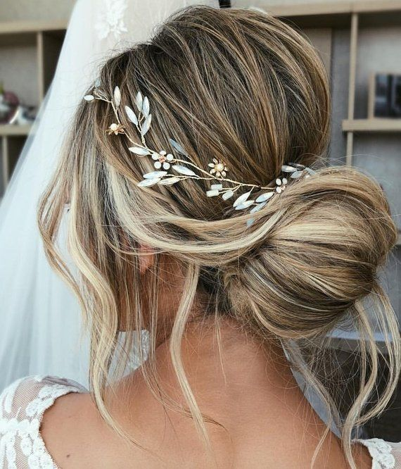 This one of a kind bridal hair vine features our characteristic combination of floral and delicate branch details, including marbled howlite gemstones accents which create an elegant and chic bridal look. Made with Opal crystals, gold plated florals, howlite gemstones, and gold plated wire.  With