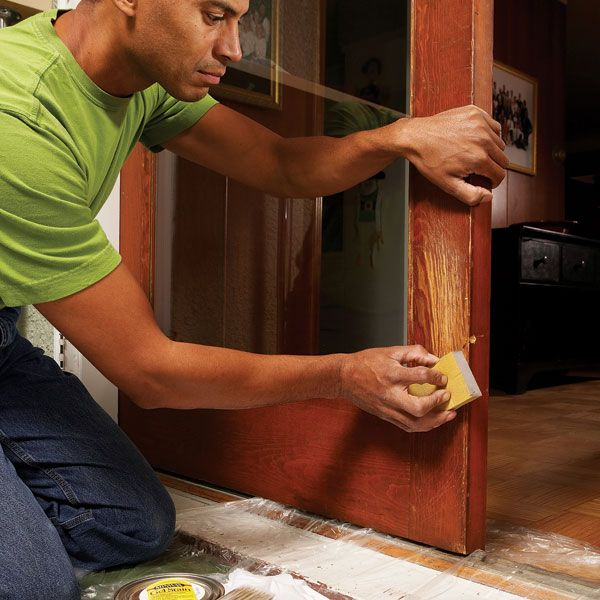 Mask shallow claw marks and scratches in wood doors with stain and varnish. Gel stains work well for matching the existing finish.