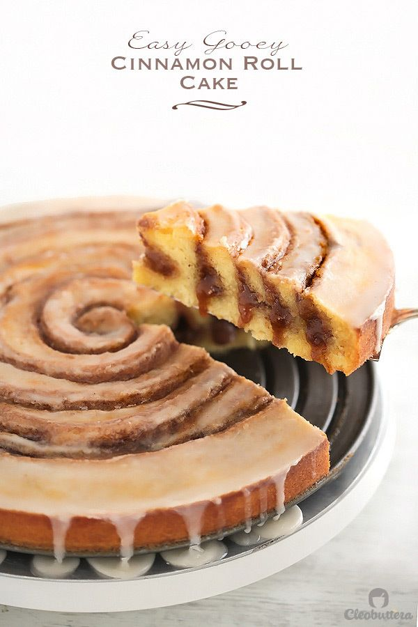 Easy Gooey Cinnamon Roll Cake - Cinnamon Goo swirls round and round. The glaze dripping off the sides is drool-worthy!
