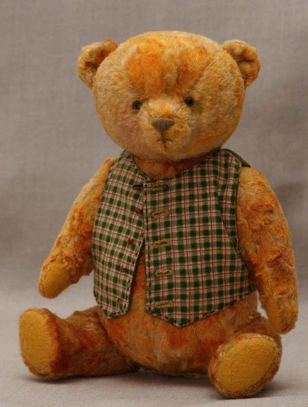 Teddy bear in green waistcoat. Hypatia.