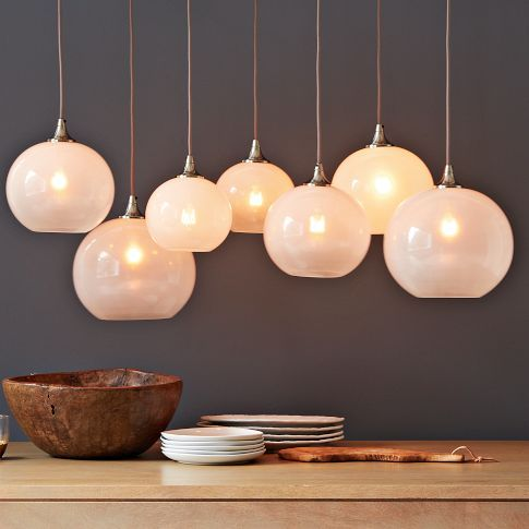 Glass orb chandelier opal seven opal glass globes that hang from a satin nickel frame the globes are adjustable in height creating a dramatic atmosphere