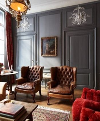 Charcoal panelled walls, leather wingback chairs