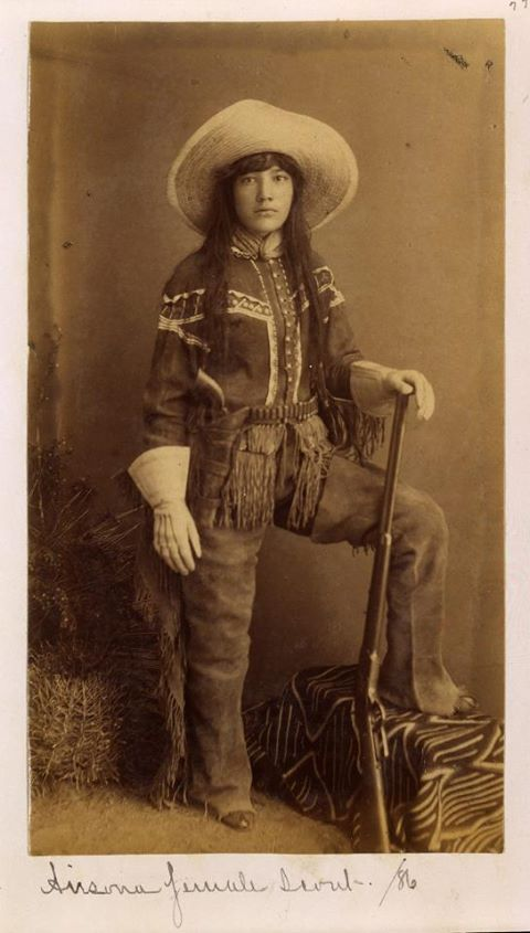 This is a cowgirl from the wild west.  She is rough and ready as shown by her attire.  Cowgirls rounded up cattle and worked in the open range along with the men.  They were strong and defended themselves from sexual attacks and abuse.  All women were not saloon girls as implied in most western movies..