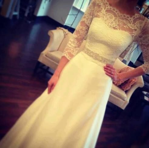 BEAUTIFUL simple wedding dress! Absolutely love...but I would prefer the layer underneath to be a little higher.
