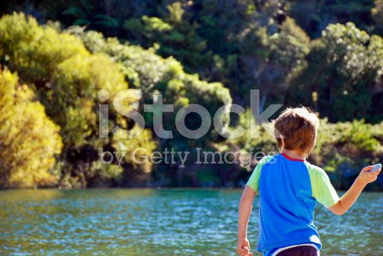Small Boy throwing Rocks in River royalty-free stock photo