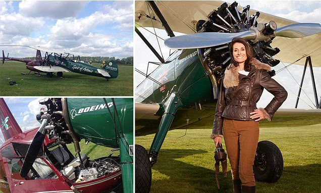 Woman pilot bidding to emulate Amy Johnson hits a parked helicopter