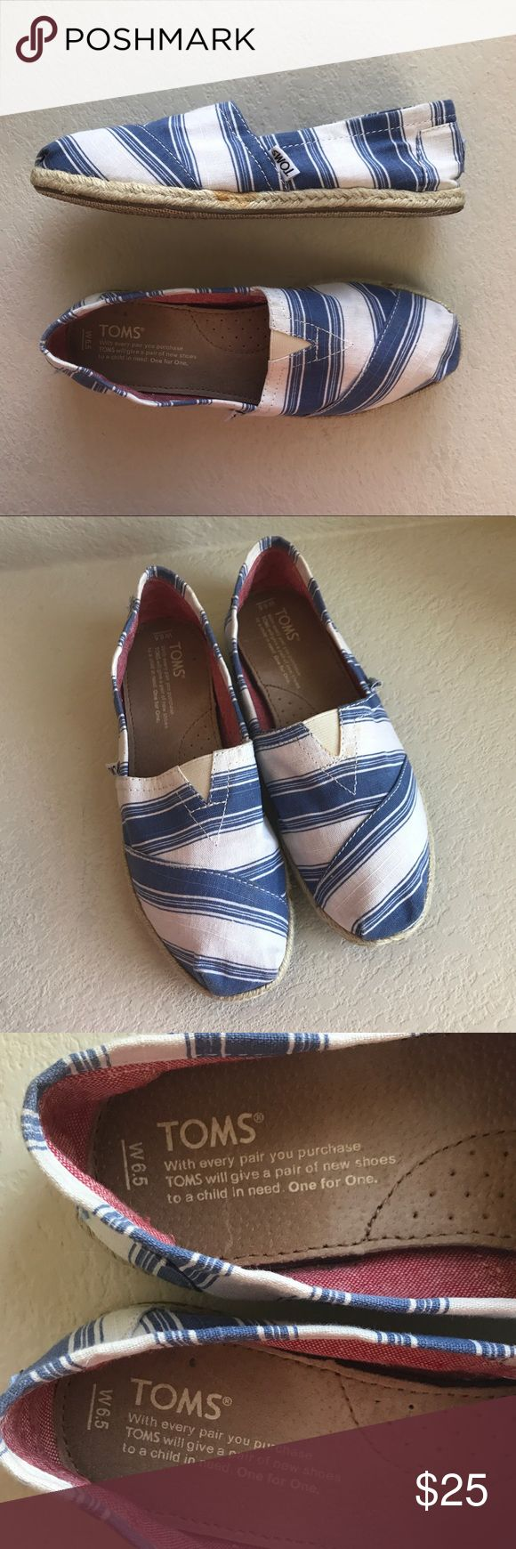 TOMS women's white and blue canvas shoes size 6.5 TOMS women's white and blue canvas fabric shoes size 6.5. Excellent condition. Clean condition and inner soles intact. No smells. Some signs of wear outside bottom of shoes as shown. Toms Shoes Espadrilles