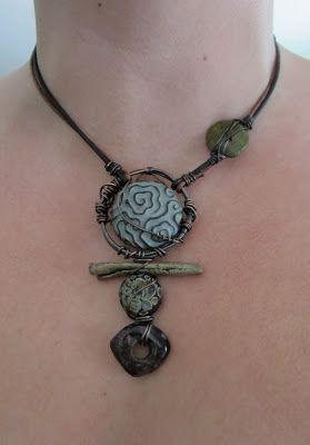Staci Louise Smith, a self taught jewelry artist, working in metal clays (silver, bronze), wire, gemstone, SEA GLASS, and metalsmithing as well.