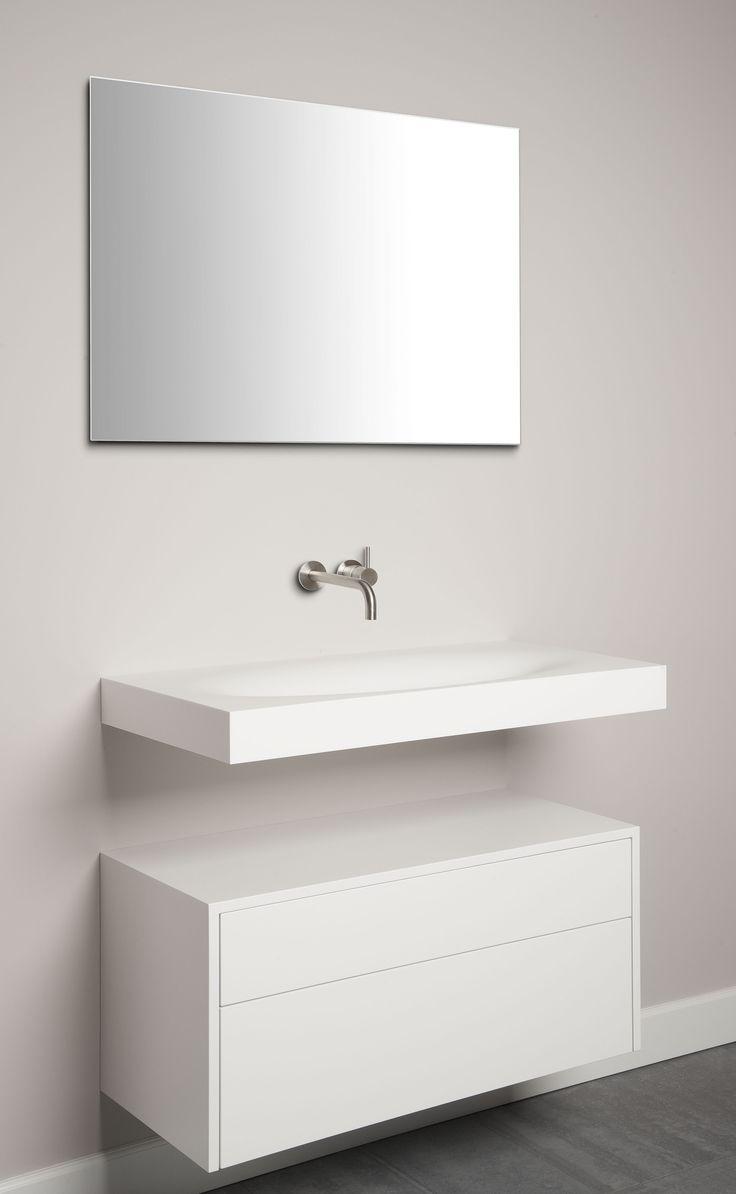 Wastafel uitgevoerd in Corian in combinatie met een vrijhangend meubel by Tiz Design.