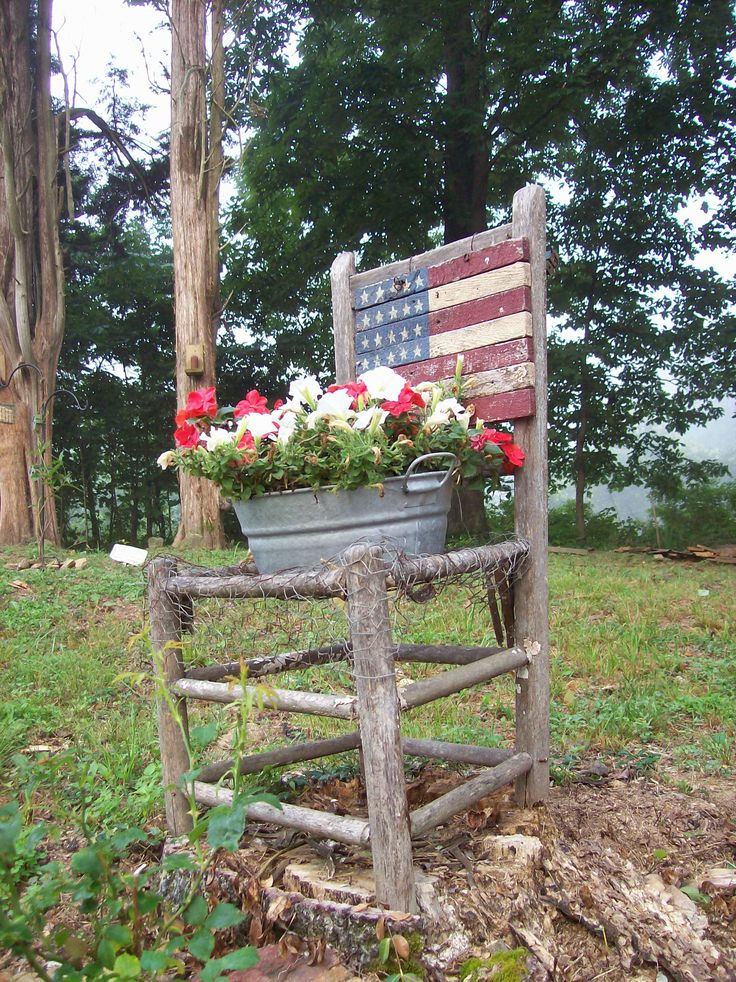Old Primitive Chair doubles as an American themed planter. Nothing (hardly) is trash for me. I lined the bottom of this old rustic chair with chicken wire and made it into a beautiful Americana piece for our landscaping.: Chairs Planters, American Theme, Primitives Chairs, Gardens Planters, Gardens Chairs, Blue Flower, Old Chairs, Americana Chairs, Primitives Gardens Ideas