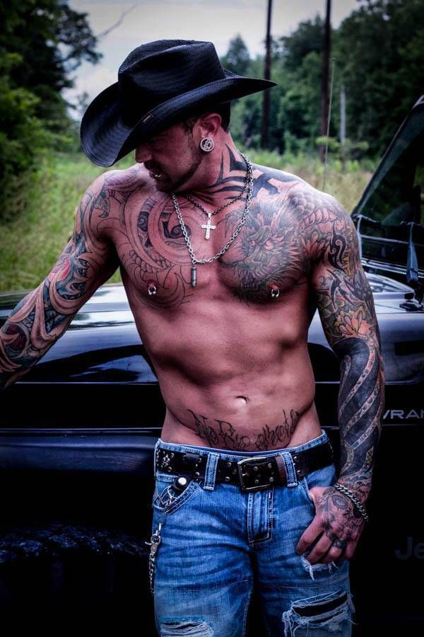 man with tattoos, and a cowboy hat???? dear lord.....lol