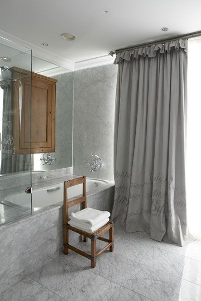 Gorgeous Gray Bathroom With Text Curtains