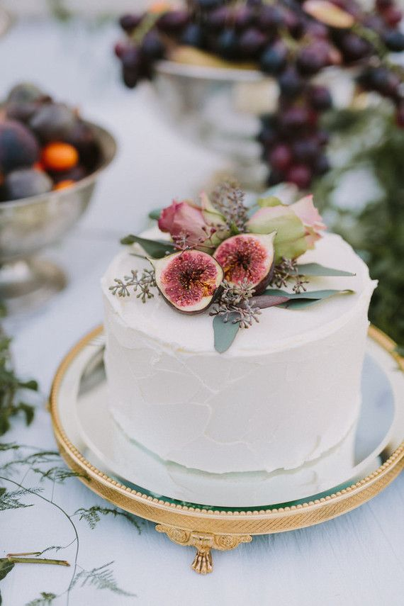 This is beautiful. The colors and the simplicity. Looks like figs and eucalyptus, roses? and some other little flower.  Gorgeous Wedding cake