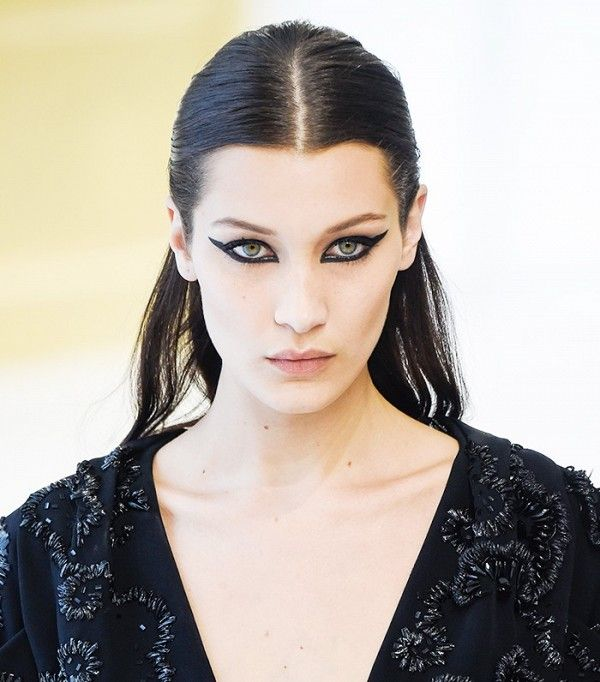Bella Hadid's intense eye makeup and slicked center-part at the Dior show were so gorgeous