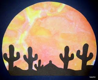 Water and Crayola watercolor markers on coffee filters make a gorgeous desert sunset.