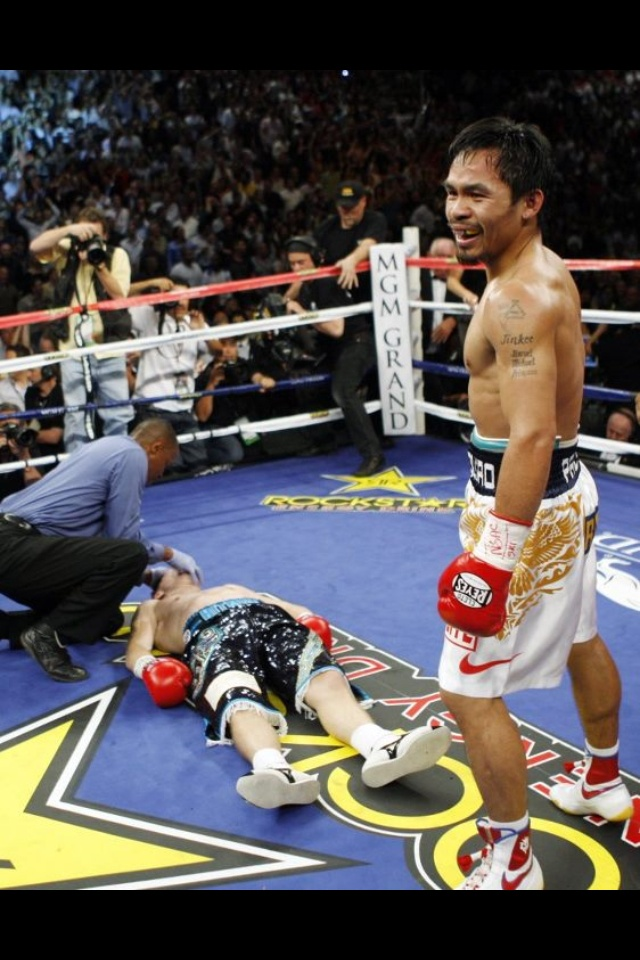 Manny Pacquiao was not this happy when he was on the floor after the big KO by Juan Manuel Marquez