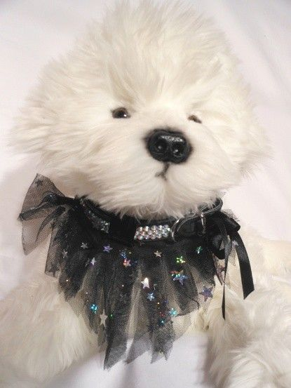 MILKY WAY  $15.00 milky way has 5 layers of black and silver star fringed tulle. with 3 black velvet keepers to slide onto a 20 ml collar. there are 2 tie on bows for you to add to your collar.