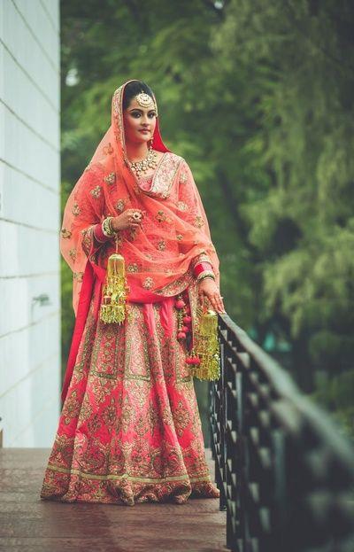 Pink and coral bridal lehenga , pink gold bridal lehenga , u shape dupatta drape , morning wedding , coral dupatta