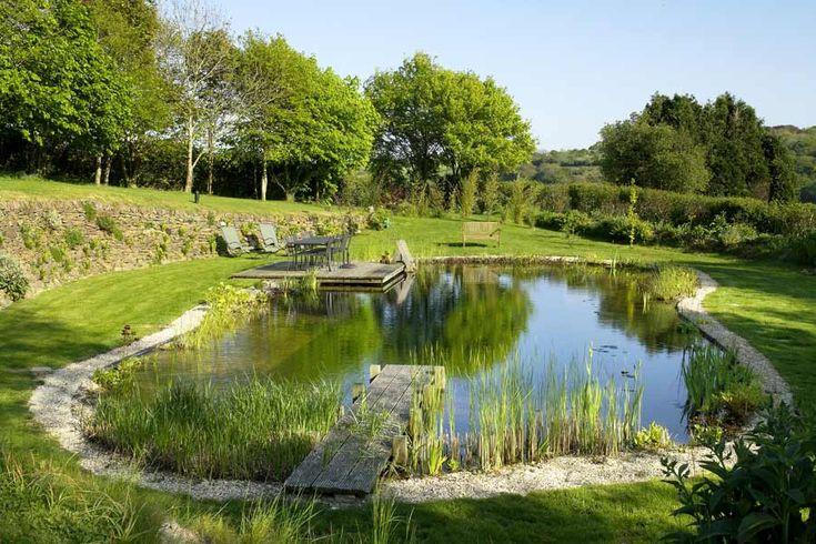 Natural swimming pond designs from gartenart natural for Natural pond design