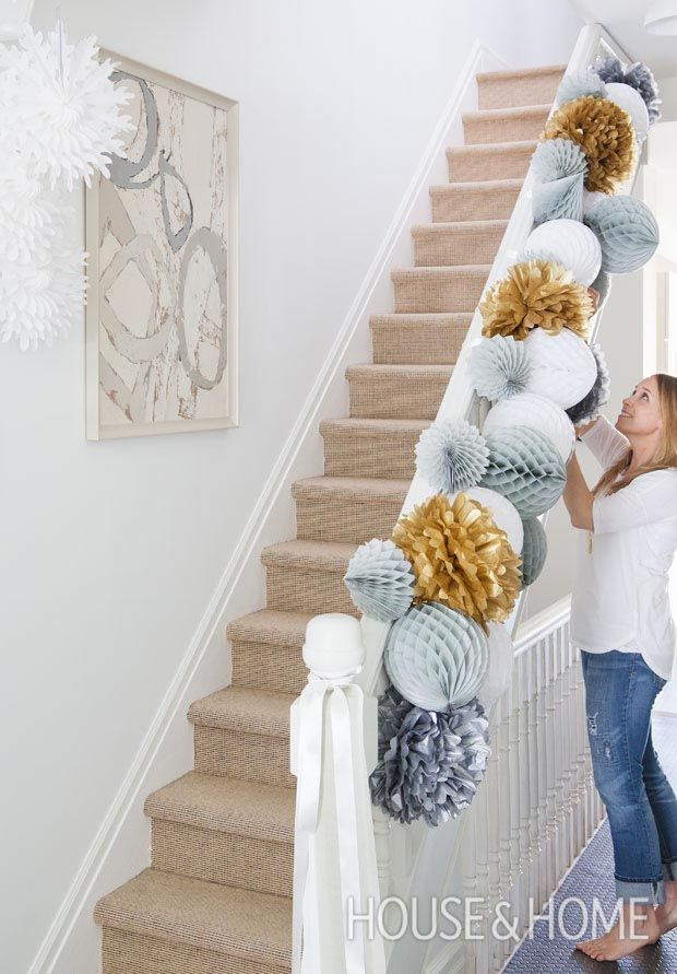 Set the tone for your holiday soiree with a standout paper garland strung on the stairs. It's fun, festive and, most importantly, dead easy. | Design: Sarah Hartill Photo: Ashley Capp and Valerie Wilcox