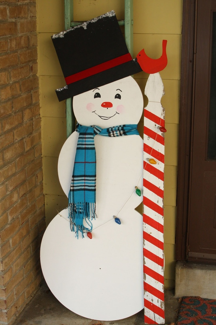 Primitive amp proper vintage snowman with candy cane picket made of