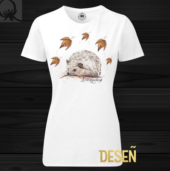 Hedgehog T-shirt by Queen Thistle Studio, printed on the white T-shirt. Slim fit Shoulder to shoulder tape  Brand Russell Fabric : 65% Polyester, 35% Ringspun combed cotton Weight: White 155gsm  Washing Instructions: Suitable for 30C machine wash.  Your body measurement  XS S M L XL Dress Size Continent 34 36 38 40 42  UK 8 10 12 14 16 France 36 38 40 42 44 Italy 40 42 44 46 48 To fit chest cm 77/82 82/87 87/92 92/97 97/102 Ins 30/32 32/34 34/36 36&#x2F...