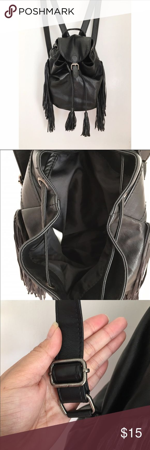 Mini leather backpack A music festival staple ! Vegan leather mini backpack with tarnished silver accents and fringe details throughout . Worn out a handful of times but still like new . No stains or flaws Abercrombie & Fitch Bags Backpacks